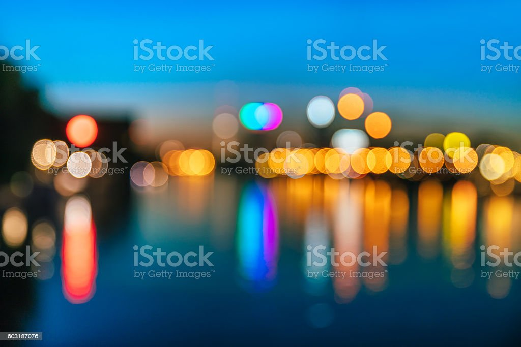 Defocused Image Of City At Night, water reflection stock photo