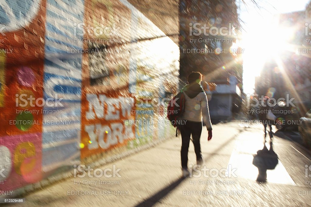 Defocused image of sun rising down a NYC street stock photo