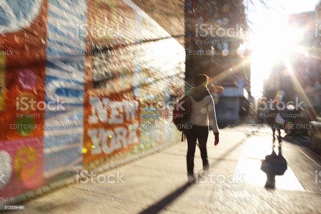 Defocused image of sun rising down a NYC street stock photo