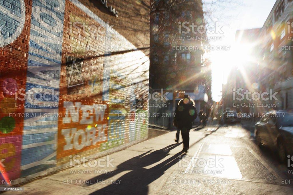 Defocused image of sun rising down New York City backstreet stock photo