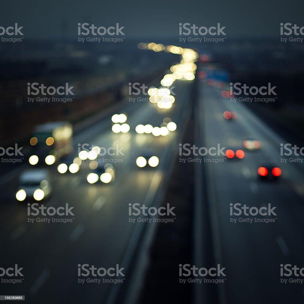 Defocused image of traffic on german autobahn at dusk royalty-free stock photo
