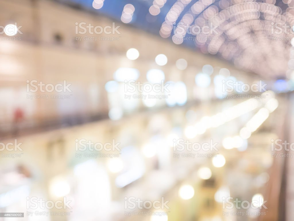 Defocused interior of a large luxury shopping center. stock photo