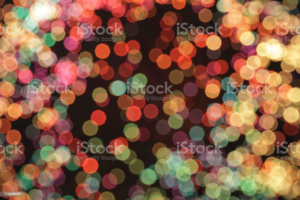 defocused multicolord light dots against black background royalty-free stock photo