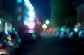 Defocused night street in blue color