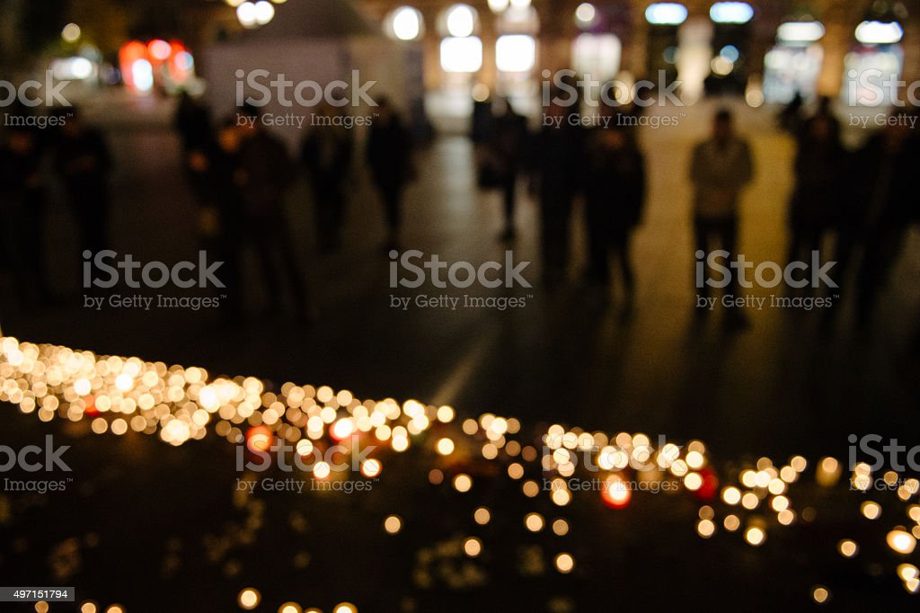 Defocused people after Paris attacks gathering stock photo