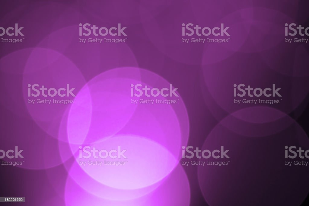 Defocused purple holiday light background stock photo