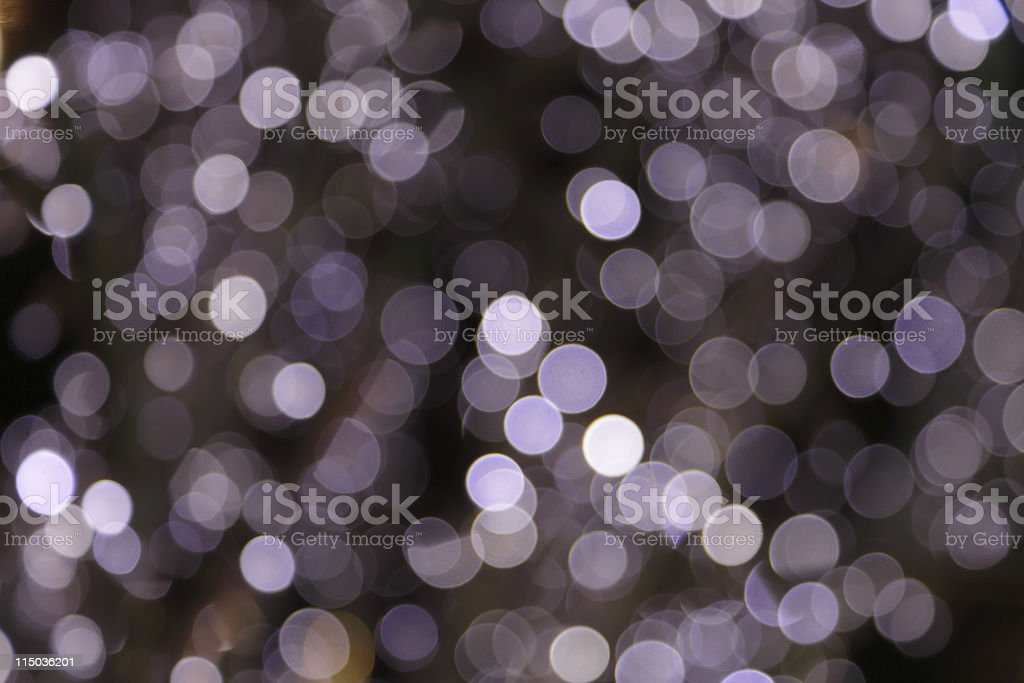 defocused purple light dots against black background royalty-free stock photo