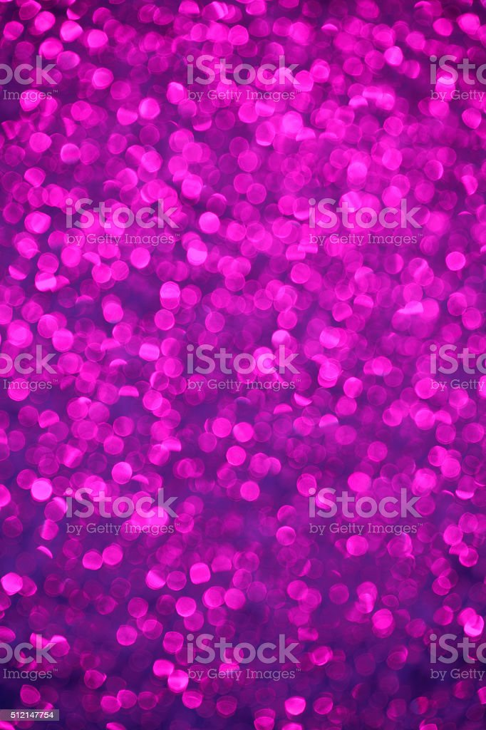 Defocused purple sparkles background stock photo