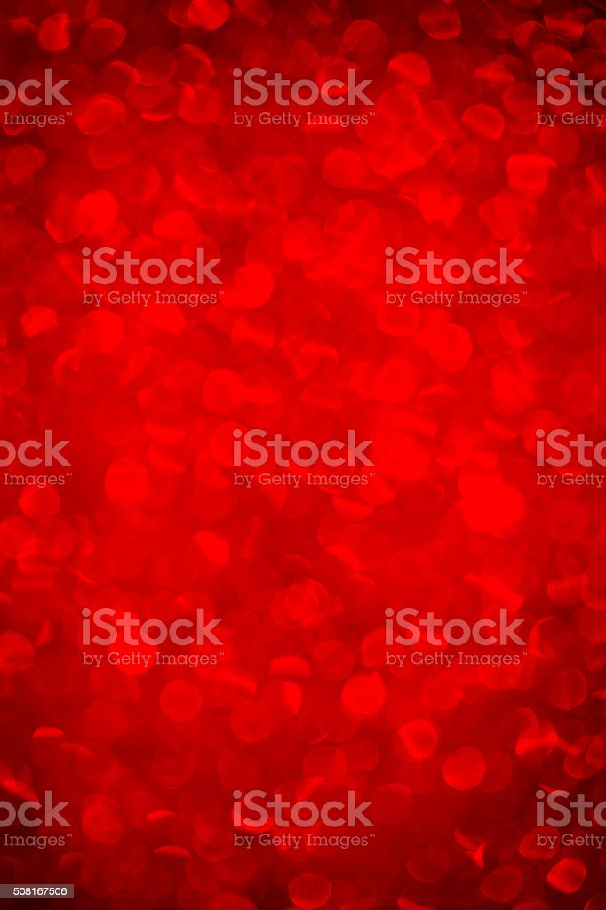 Defocused red sparkles background stock photo