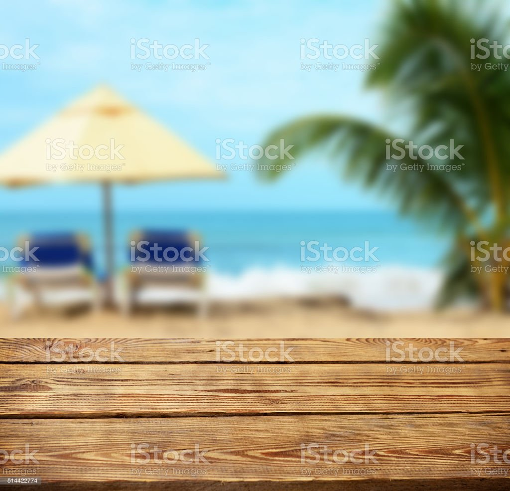 defocused sea and wooden background stock photo
