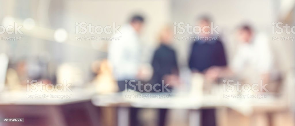 Defocused shot of architect explaining project plan to clients stock photo