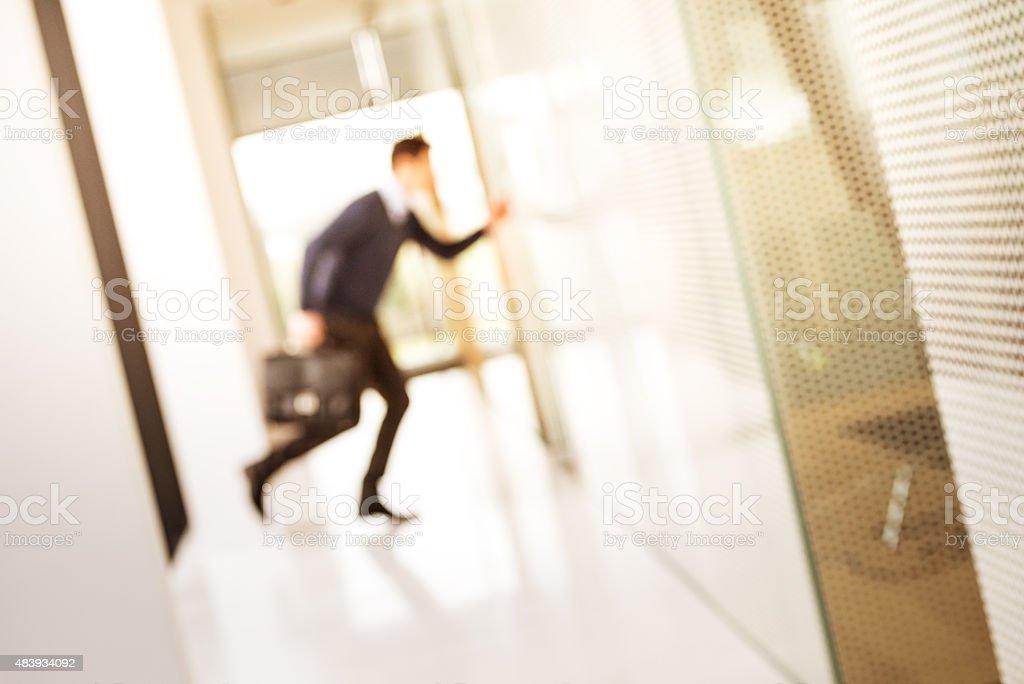 Defocused Shot of Businessman Running stock photo