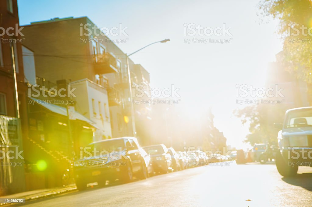 Defocused tilted Brooklyn street back lit with flare stock photo