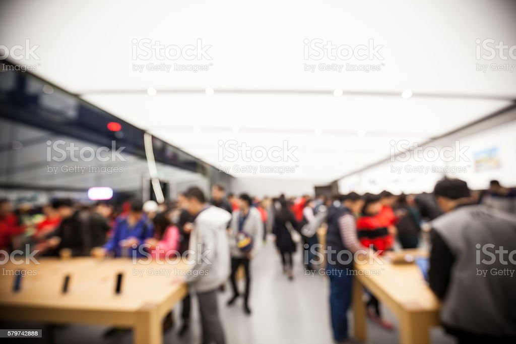 Defocused view of lots people in retail store stock photo