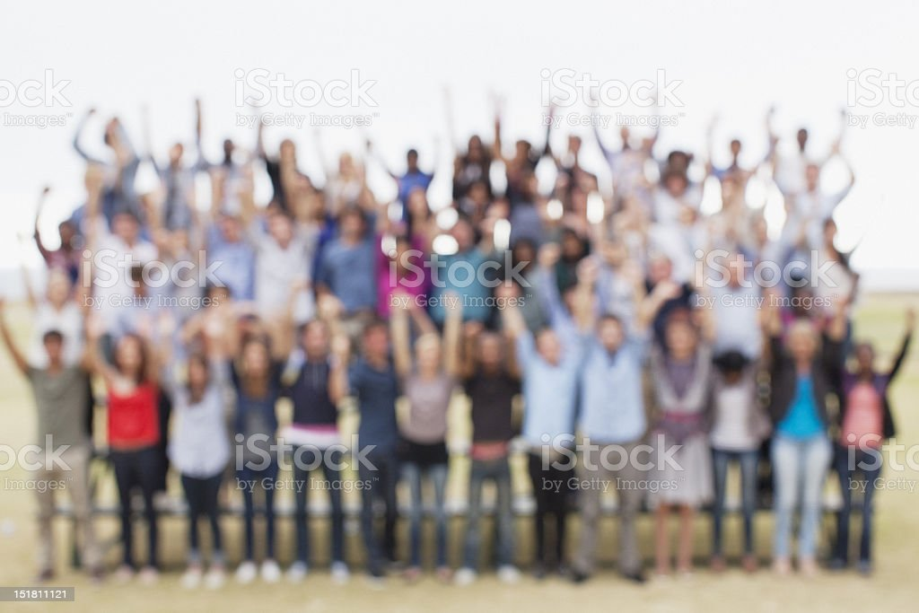 Defocused view of people with arms raised royalty-free stock photo