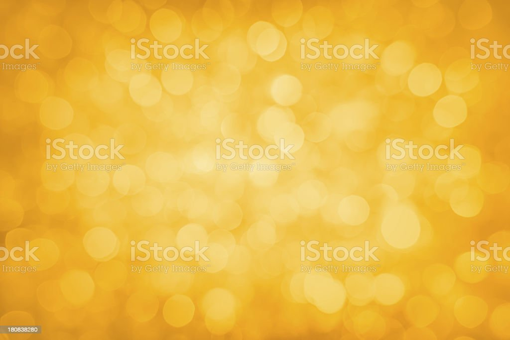 Defocused yellow sparkles stock photo