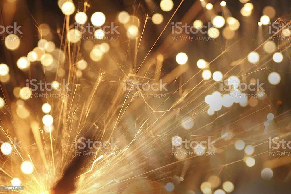 Defocussed glowing sparkler with blurred motion stock photo