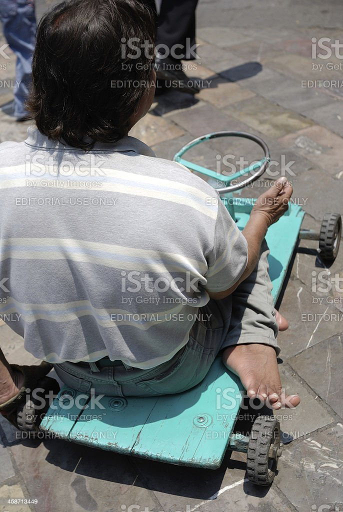 Deformed man  begging on the streets of Puebla, Mexico royalty-free stock photo