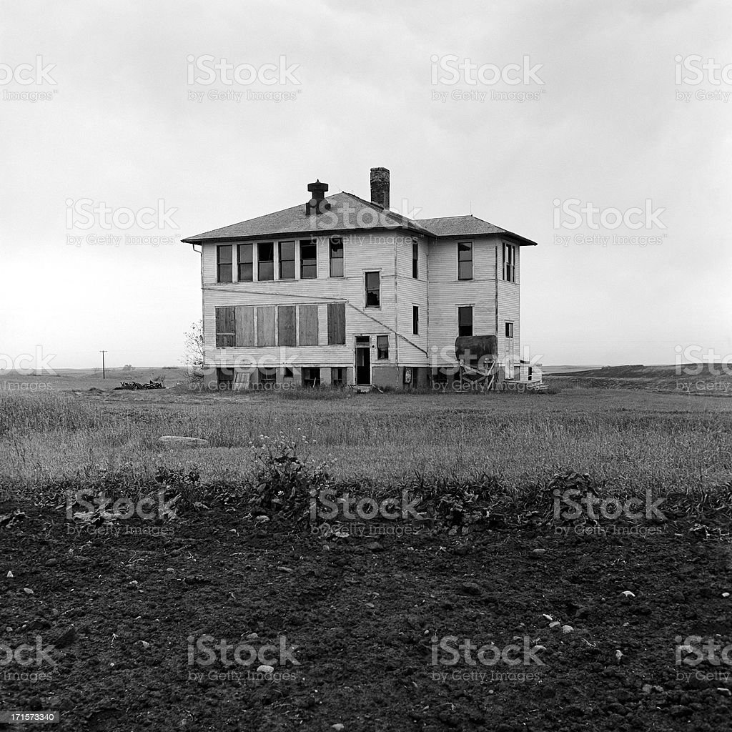 A defunct rural school building in black and white picture royalty-free stock photo