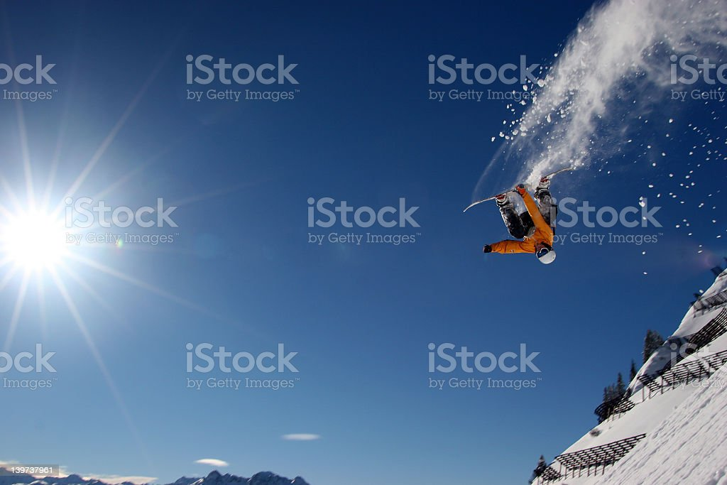 360 degree snowboard jump on a beautiful clear day stock photo