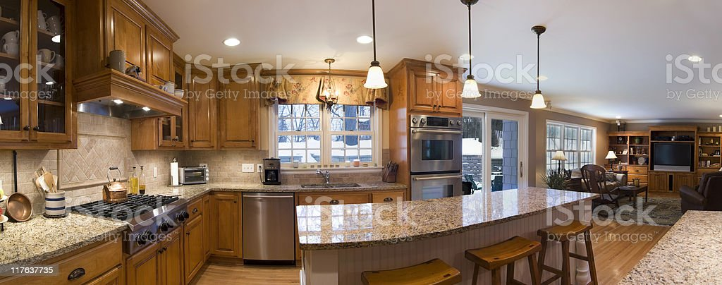 A 180 degree view of a kitchen and living area stock photo