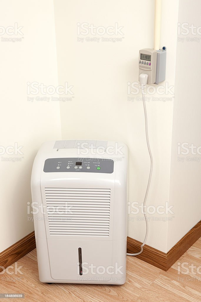 Dehumidifier and Electric Meter stock photo