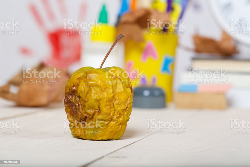 Dehydrated green apple on a wooden surface stock photo