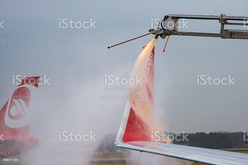 Deicing of Airberlin Wingtip during Winteroperation stock photo