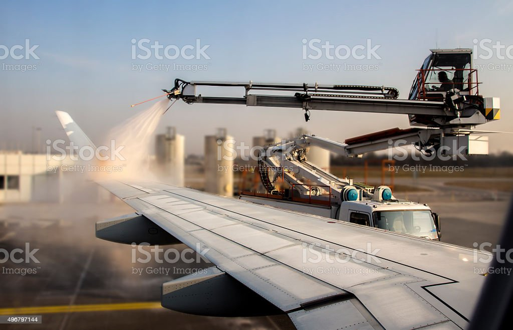 De-icing of an airplane at Munich Airport, Germany, 2015 stock photo