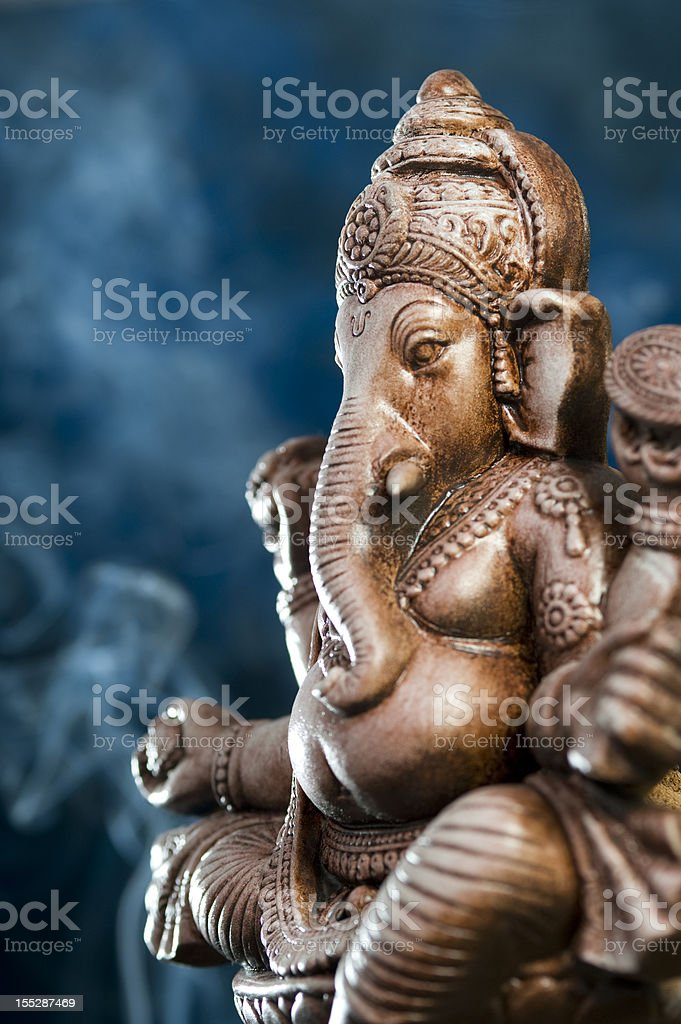 Deity of Ganesha from India on blue background stock photo