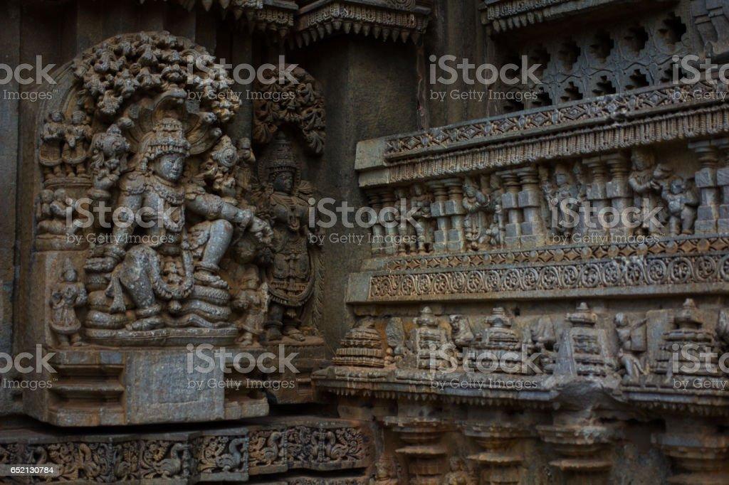 Deity sculpture on shrine outer wall in the Chennakesava temple at Somanathapura, Karnataka, India, Asia stock photo