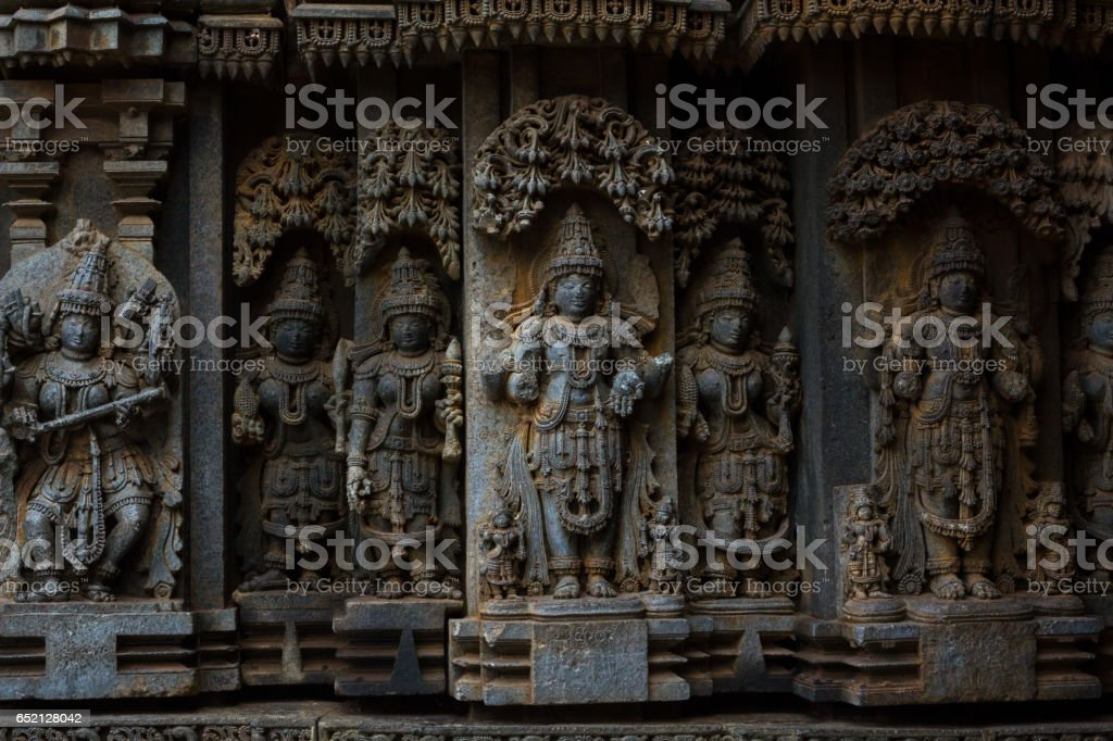 Deity sculpture under eves on shrine outer wall in the Chennakesava temple at Somanathapura, Karnataka,India, Asia stock photo