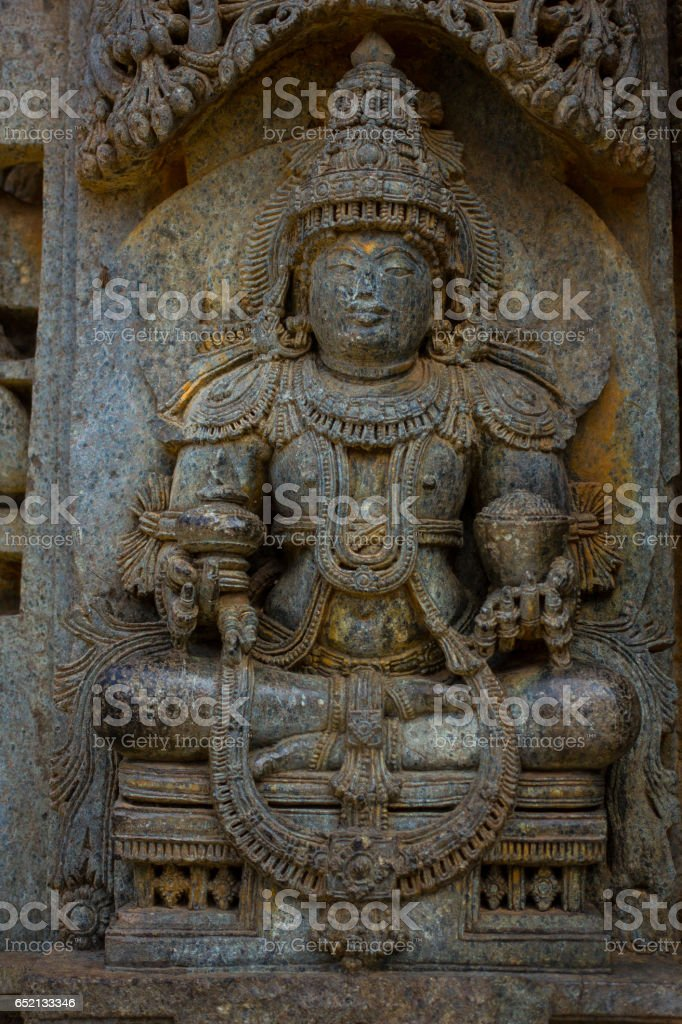 Deity sculpture under eves on shrine outer wall in the Chennakesava temple at Somanathapura, Karnataka, India, Asia. stock photo