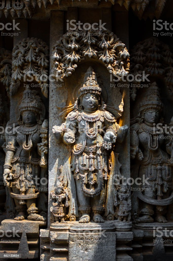 Deity sculpture under eves on shrine outer wall in the Chennakesava temple at Somanathapura, Karnataka,India,Asia stock photo
