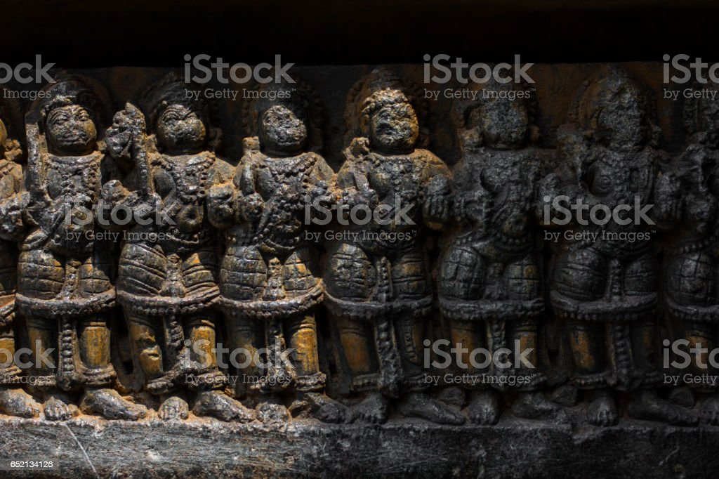 Deity sculpture under eves on shrine outer wall in the Chennakesava temple at Somanathapura, Karnataka,India, Asia. stock photo