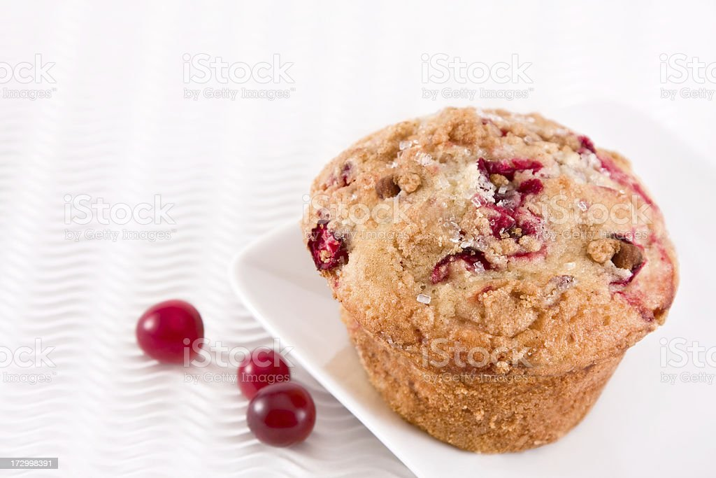 A delectable Cranberry muffin on a plate royalty-free stock photo