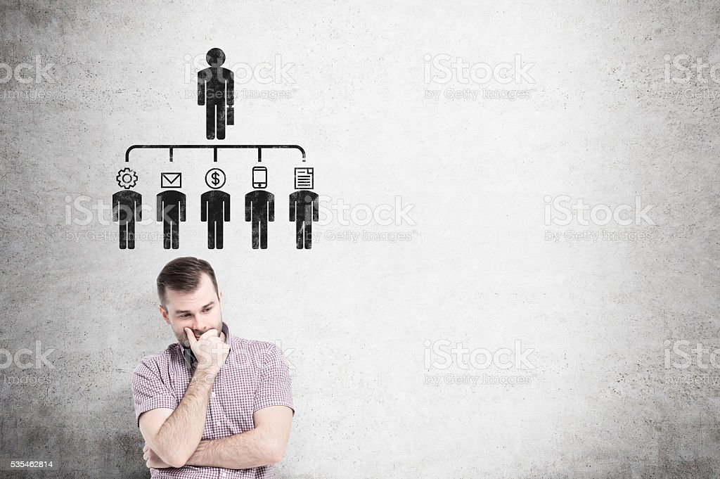Delegating pictogram on concrete wall stock photo