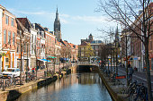 Delft bike route along city canal in spring