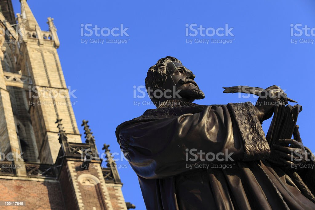 Delft's Nieuwe Kerk with statue of Hugo Grotius in front royalty-free stock photo