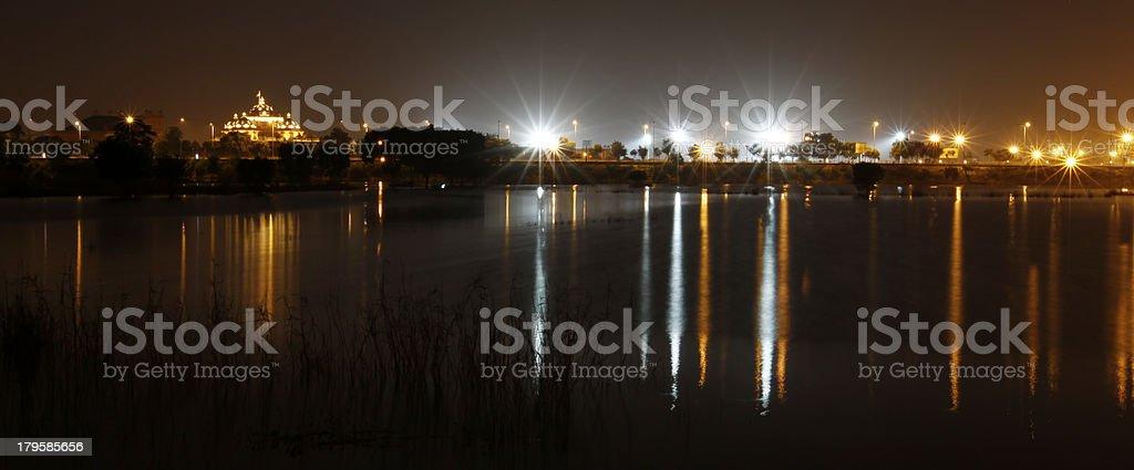 Delhi City lights reflecting on a river. royalty-free stock photo