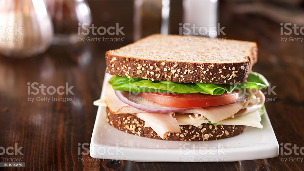 deli meat sandwich, shot at a wide aspect ratio stock photo
