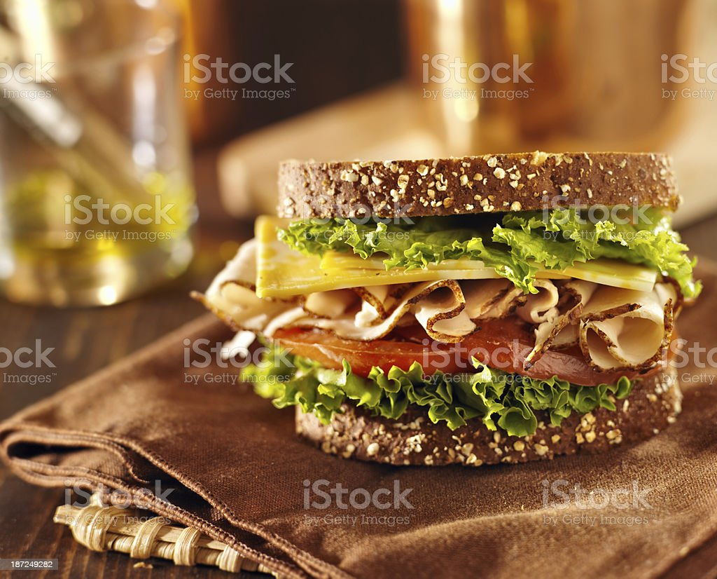 Deli meat sandwich with turkey on brown towel stock photo