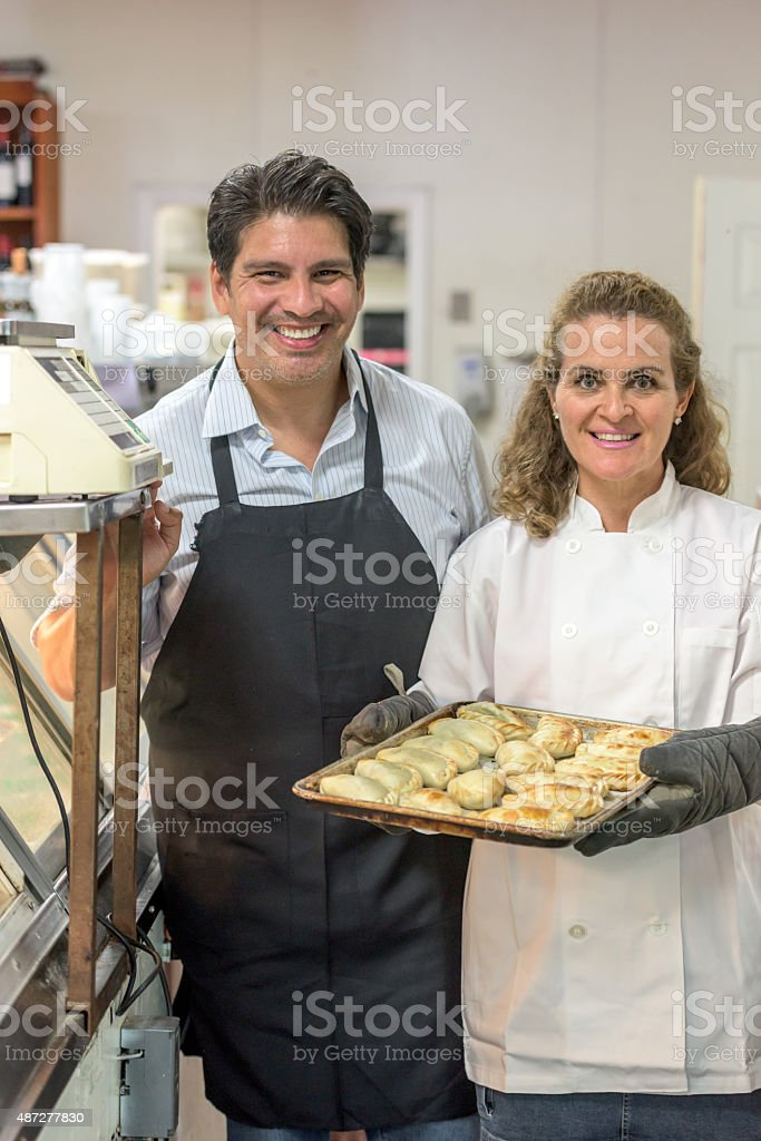 Deli Owners posing Smiling stock photo