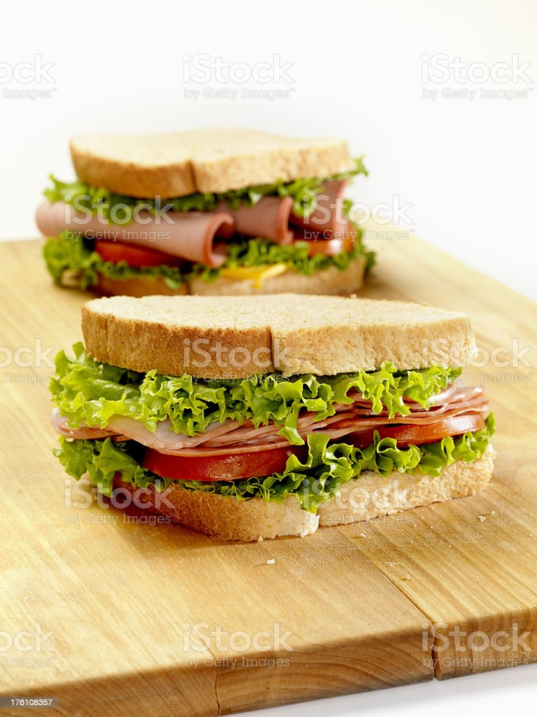 Deli Sandwiches on a Cutting Board royalty-free stock photo