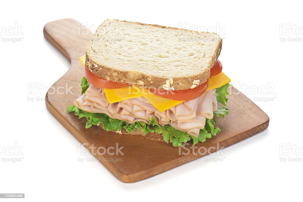 Deli Style Turkey Sandwich on Cutting Board stock photo