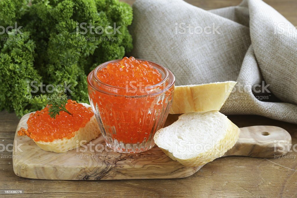 delicacy appetizer red caviar on a white baguette royalty-free stock photo