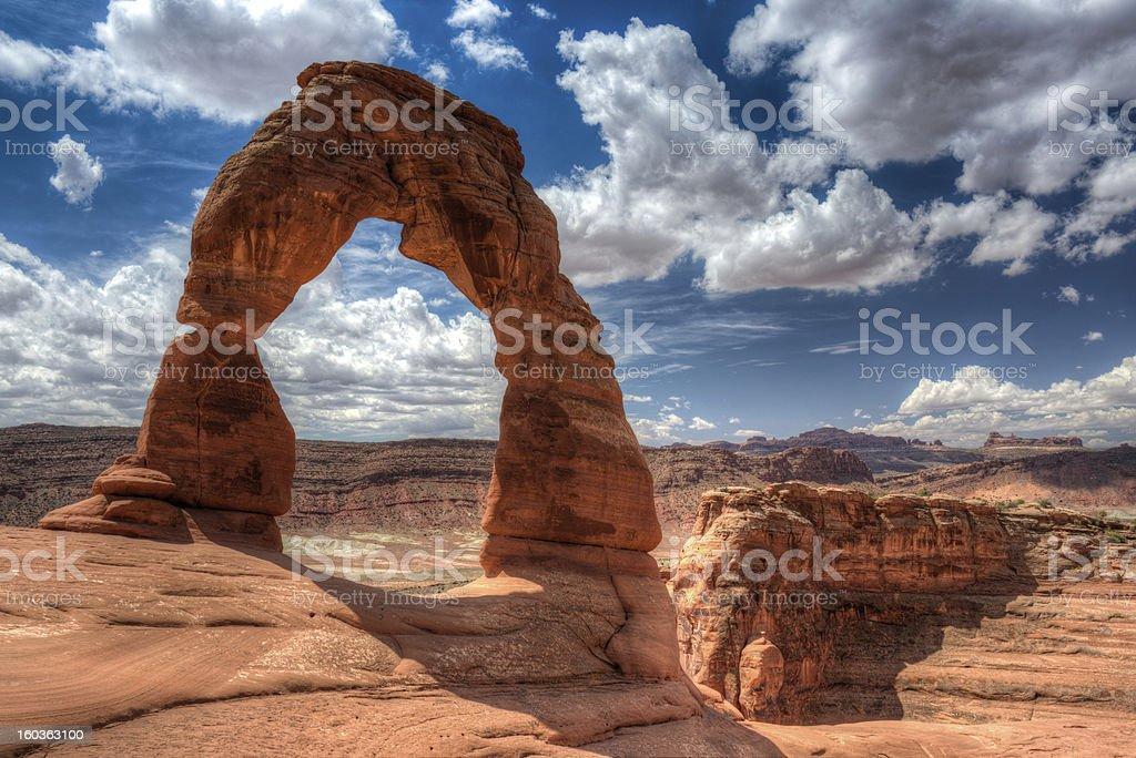 Delicate Arch, Arches NP, Cloudscape stock photo