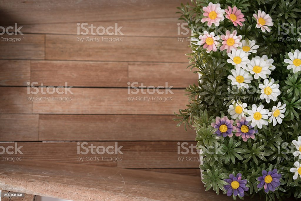 Delicate daisy bouquet with wood bacground stock photo
