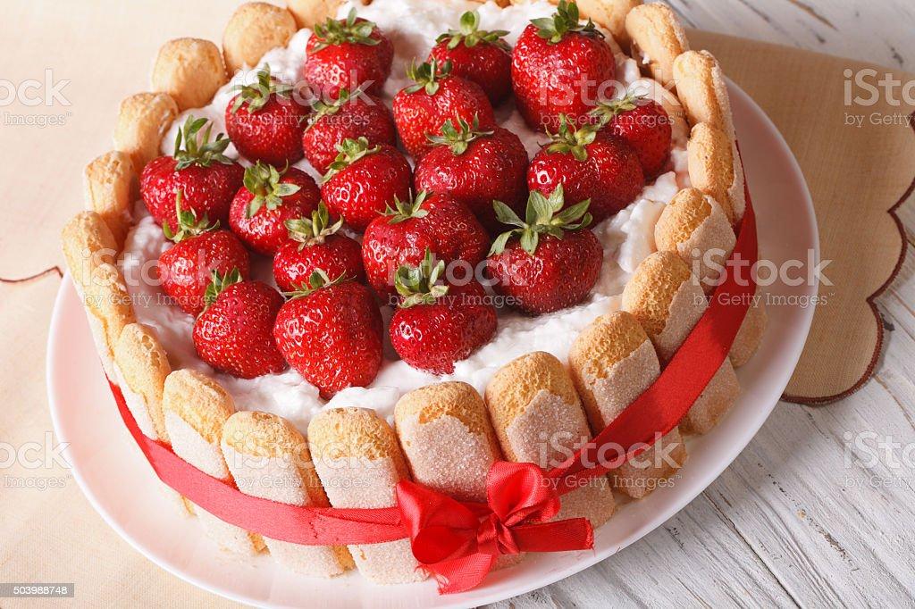 Delicate dessert strawberry cake closeup on the table. horizonta stock photo