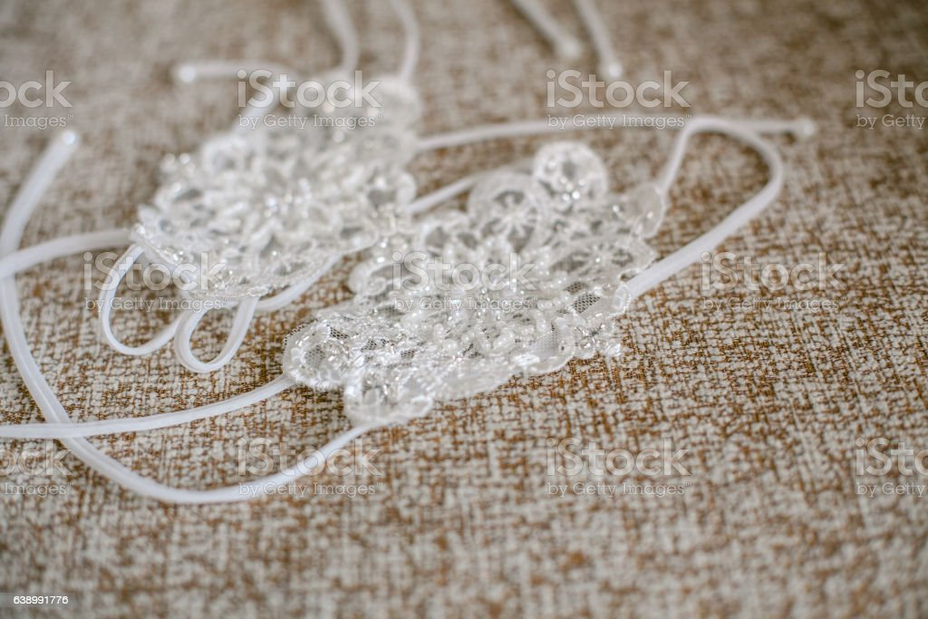Delicate detail of a wedding dress. Fine lace. stock photo